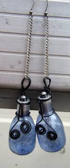 With silver chain holding them up, the star is a blue light bulb [yes, its  real] that's been wire wrapped in ...