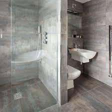 dark grey tiled bathroom with walk in shower