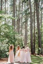 bride and bridesmaids walk in forest brookgreen gardens murrells inlet south ina