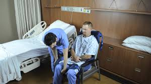 transferring patient from chair to bed with opti pose sling and ceiling lift you