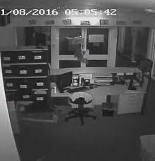 crocs office. The Crocs Were Pushed Through A Broken Window On Front Door Of Office