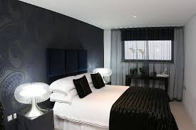 ... Refined contemporary bedroom with dark sheer curtains [Design: Sacha  Jacq Interiors LLC]