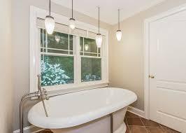 master bathroom with nickel beehive pendant lighting