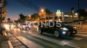 busy traffic on santa monica boulevard in west hollywood at dusk 4k uhd 71817460