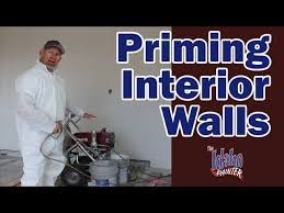 priming and painting walls painting new