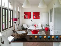 red abstract painting prints in a french home