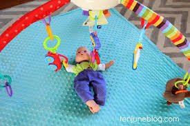 a model for my new play mat so instead of attempting to capture a rambunctious hdawg lying still under the mat i used his baby doll i m weird i know
