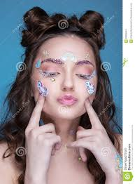 beautiful fashion with funny professional makeup and emoji stickers glued on the face