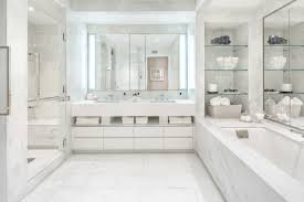 Marble bath with shower on one side and tub with surround on opposite side.  Q: How ...