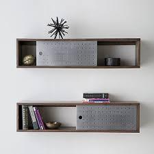 dark mango wood shelf slides single perforated aluminum door to expose or enclose knick knacks and
