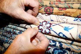 in his eponymous kermanshah oriental rugs near union square he pulls out antique persian rugs made of