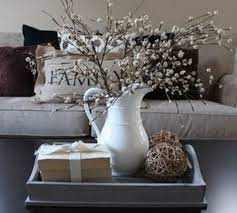 It lets you create a warm and inviting look with your favorite decor, collectibles, potted plants etc. 53 Coffee Table Decor Ideas That Don T Require A Home Stylist Decor Home Decor Farm House Living Room