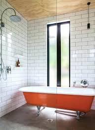 clawfoot bath tub shower a bold orange bathtub in the shower zone with subway tiles clawfoot