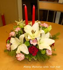 adorable ideas for table centerpieces design featuring pretty flowers bouquet table centerpiece and red color candles