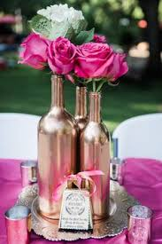 Hot pink roses and white hydrangeas. Rose Gold Wine bottle center pieces,  and mercury