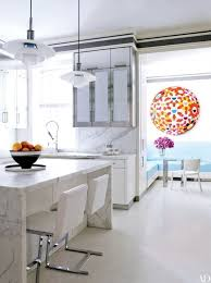 a work by takashi murakami brightens the breakfast area in a david kleinberg designed manhattan home the kitchen counters and backsplashes are of calacatta