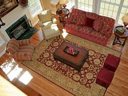 living room with red furniture. extra large living room rugs with red furniture sofa and chairs bench fireplace also carpet laminated wooden floor decorative lamps on nightstand c