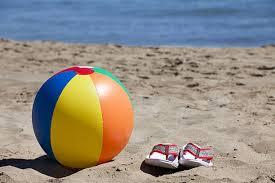 beach ball on beach. Beach Ball And Flip-Flops In The Sand On