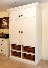 Large White Wooden Pantry Cabinet With Two Layers Storage On The ...