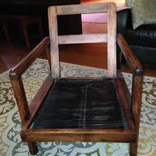 i have an wooden armchair that my father loved it had two leather cushions that made chair up it has u s v a marked on the bottom of it