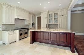 antique white kitchen cabinets with dark wood island