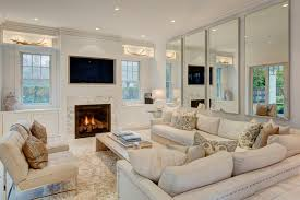 recessed lighting wooden coffee table crown molding rug living room living room rugs built cabinets white wall mirrors contemporary style built cabinets