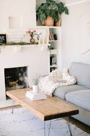 Living space complete with a cozy chunky knit blanket from Crafters Box. Minimal  home decor ideas.