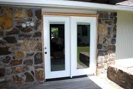 patio door with blinds between
