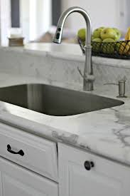 now formica offers an ideal edge and the option for an undermount sink combining those two elements with their calacatta marble gave us our vision