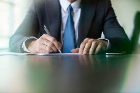 businessman doing paperwork 58a1e0ab5f9b c60b738