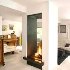 indoor outdoor wood fireplace see through
