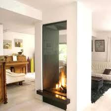 indoor outdoor wood fireplace see through