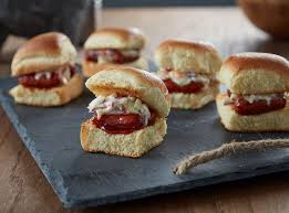 this slider recipe has caramelized hillshire farm lit l smokies smoked sausages layered in hawaiian style rolls with creamy slaw and y bbq sauce