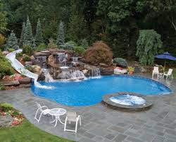 Exterior Inground Pool With Water Slide And Rock Waterfall Built In