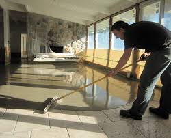 a concrete overlay can be applied directly over existing flooring such as tiles pictured