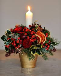 Christmas arrangement with candle and dried oranges