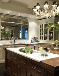 design with crystal chandelier walnut island marble cutting board ivory glass front kitchen cabinets and countertop diy