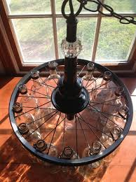 super cool glass bottle chandelier realized with a bicycle rim