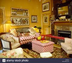 striped sofas living room furniture. Pictures Above Red Striped Sofa In Country Living Room With Pink Ottoman Front Of Fireplace Leather Club Fender Sofas Furniture