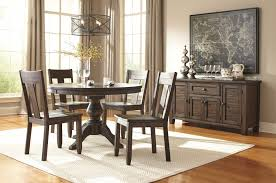 trudell golden brown round dining table 4 side chairs