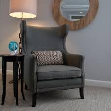 gray wingback chair. Master Suite Sitting Area Features Upholstered Wingback Chair Gray