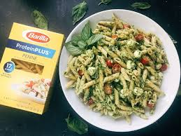 less than 25 minutes to make this fresh basil pesto pasta with cherry tomatoes and fresh