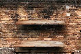 brick shelf empty wood shelves on old brick wall background grunge industrial interior uneven diffuse lighting brick shelf attach shelf to wall shelves