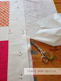crazy mom quilts: Machine Quilting 101: Basting & After an hour or so (depending on your quilt and the speed at which you  pin) the quilt should look something like this. Nice and flat and all  pinned ... Adamdwight.com