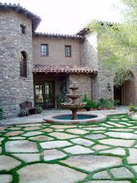 flagstone patio with grass. Tuscan, Stone, Flagstone Motorcourt Mediterranean-patio Patio With Grass