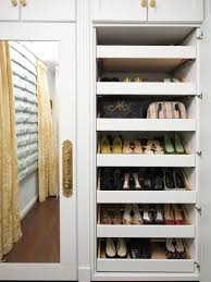 Closet - traditional women's dark wood floor closet idea in Detroit with  open cabinets and white