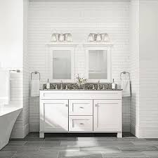 white and gray bathroom with marble top double vanity and double vanity lights