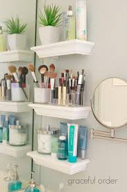 organizing small bathroom sinks with floating shelves. But this would look  good in a large bathroom as well!