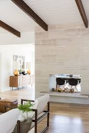 white stone fireplace with exposed wood ceiling
