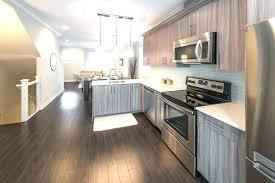 gray hardwood floors in kitchen dark grey wood floors white kitchen cabinets with dark hardwood floors